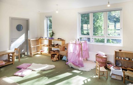 Classroom for young children with wooden furniture and toys