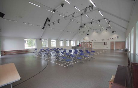 Large school hall set up with folding chairs
